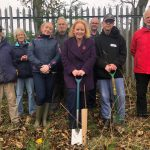 Judith helps to plant Queen's Commonwealth Canopy saplings in Wibsey
